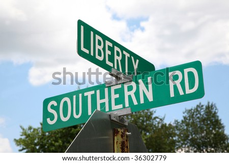 Street sign showing the symbolism between life in the south (USA) and the pursuit of liberty.