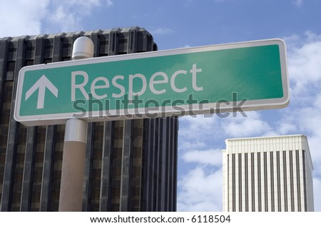 "Street sign with an arrow and the words ""respect"" located in a business district - stock photo"