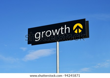 "Street sign with upward arrow reading ""growth"" - stock photo"