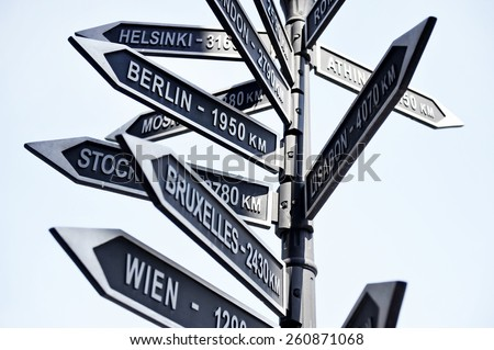 Street signpost showing distance to Europe capital cities - stock photo