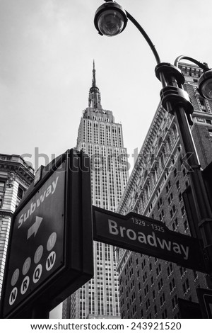 Street signs and Empire State Building B&W - stock photo