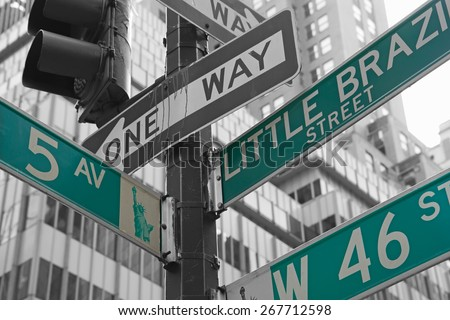 Street signs for Fifth Avenue, West 46nd street and Little Brazil  in Manhattan (New York City). Color Splash Effect Picture. - stock photo