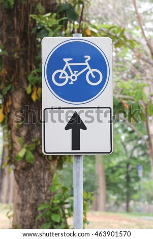Street signs in road for bicycle only one to carriageway.
