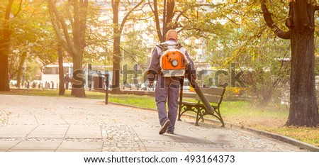 Street sweeper collects leaves from the fan motor, Cleaning the streets of leaves