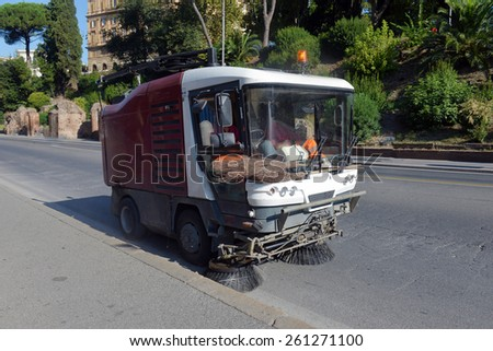 street sweeper machine cleaning the streets - stock photo