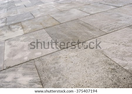 Street tiled stone pavement as backround - stock photo