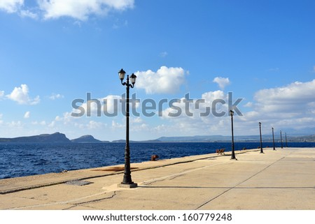 Street torch on empty seafront, Pylos, Greece