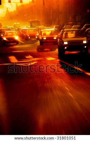 Street traffic in the morning - motion blur image - stock photo