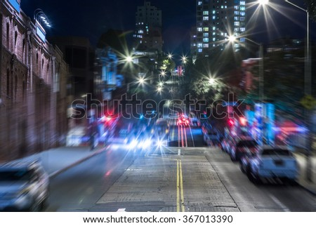 street tram / train in downtown San Francisco at night. - stock photo