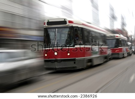 Street trams on Toronto street in motion blur - stock photo