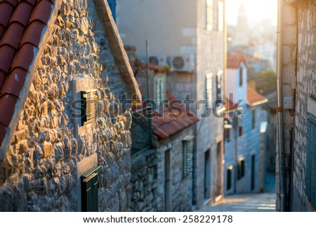 Street view in old city center of Split in Croatia in the sunset - stock photo