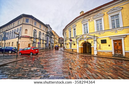 Street view in the Old Town of Vilnius in Lithuania in rainy weather at Christmas in winter - stock photo
