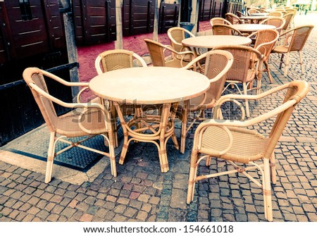 Street view of a coffee terrace with tables and chairs, France - stock photo