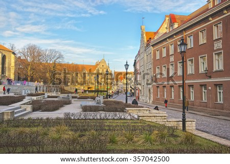 Street view of a square near St Nicholas Church in the Old city of Tallinn in Estonia, in winter - stock photo