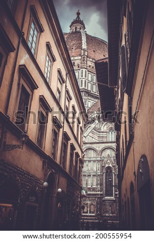 Street view of Basilica of Saint Mary of the Flower - Basilica di Santa Maria del Fiore. Duomo of Florence, Italy. Toned picture - stock photo