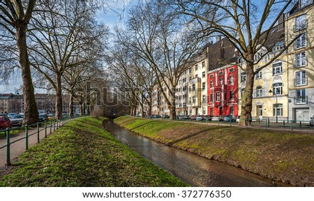 """Street view of Dusseldorf with the little river """"Duessel"""" in Germany - stock photo"""