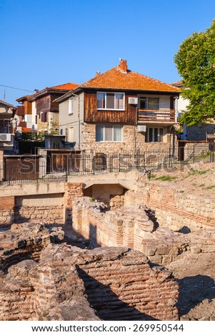 Street view of Nesebar, Bulgaria. Typical revival houses and ancient ruins in the old town. Vertical photo - stock photo