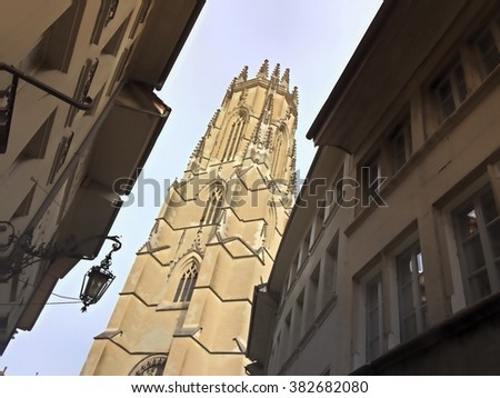 Street view of the St-Nicolas cathedral in the city of Fribourg (Switzerland) - stock photo