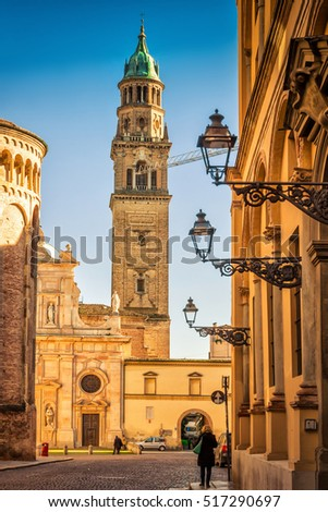 Street view of the tower and San Giovanni Evangelista church in Parma, Emilia-Romagna, Italy.