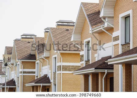 Street view on a  row of a new modern residential house complex - stock photo