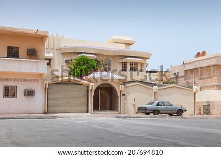Street view with old parked car, Rahima town, Saudi Arabia - stock photo