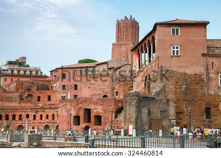 Street view with remains of Imperial forums in Rome Italy - stock photo