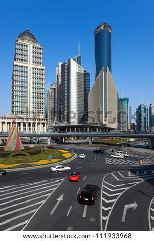 street views of shanghai finance and trade zone at daytime - stock photo