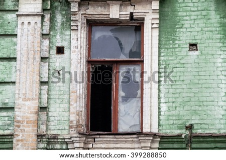 street window in a brick old house - stock photo