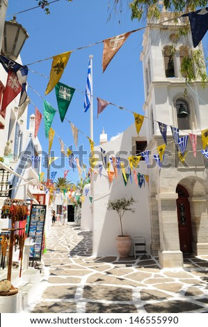 Street with banners in Mykonos, Greece - stock photo