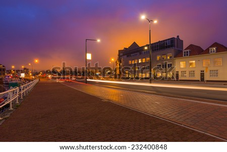 Street with Car Light Strips at Dusk, Delft, The Netherlands. - stock photo