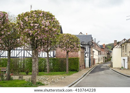 Street with cherry flowers in Le Bec-Hellouin, Normandy, France - stock photo