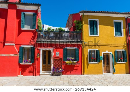 Street with colorful buildings in Burano island, Venice - stock photo