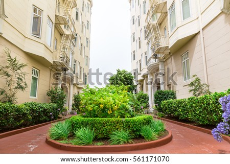Street with green flower bed