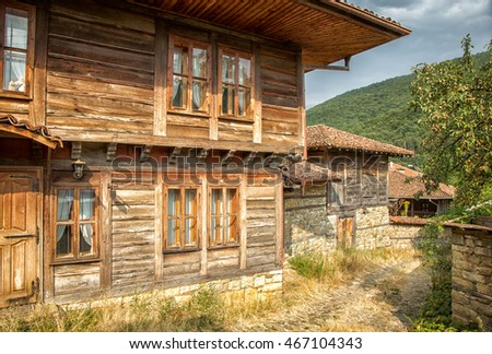 Street with historic architecture in the old village,travel on Bulgaria. Ancient buildings and cobbled road in medieval style - architectural landmarks of Europe.
