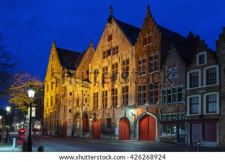 Street with historic houses in Bruges city center at evening, Belgium - stock photo