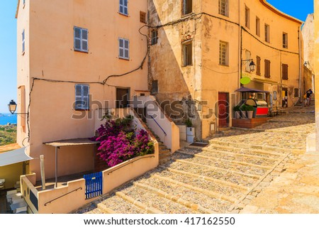 Street with historic houses in Calvi old town, Corsica island, France - stock photo