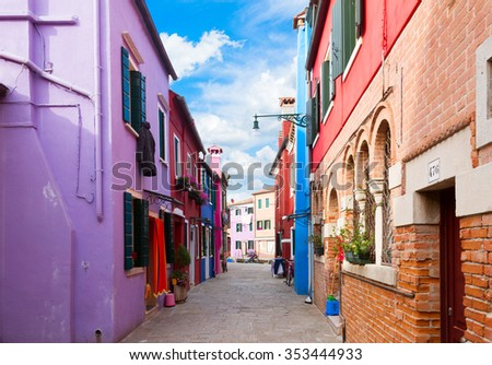 street with multicolored houses of Burano island, Venice, Italy