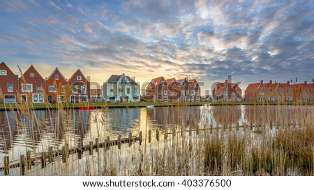Street with New Modern Houses on the waterfront in a newly built ecological Urban Area in the Netherlands - stock photo