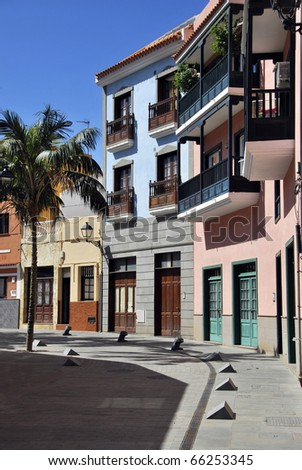 Street with painted houses in Puerto de la Cruz. Typical architecture. Tenerife. Canary Islands. Spain - stock photo