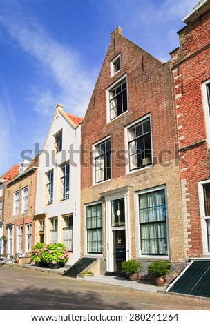 Street with row of ancient brickwork mansions, Veere, Netherlands - stock photo