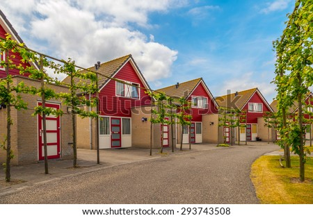 Street with vacation rentals in a beach resort in the netherlands - stock photo