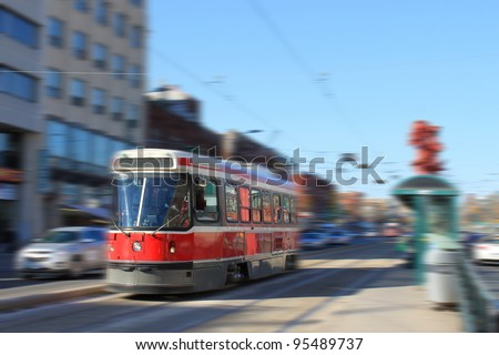 Streetcar transportation in downtown Toronto, Canada with motion blur - stock photo