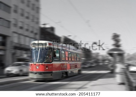 Streetcar transportation in downtown Toronto, Canada with motion blur in black and white and color