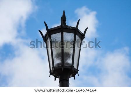 Streetlight against a cloudy sky background - stock photo