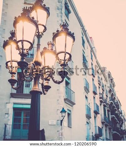 Streetlight against building facade - stock photo
