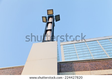 Streetlight waiting for darkness to start lighting the street - stock photo