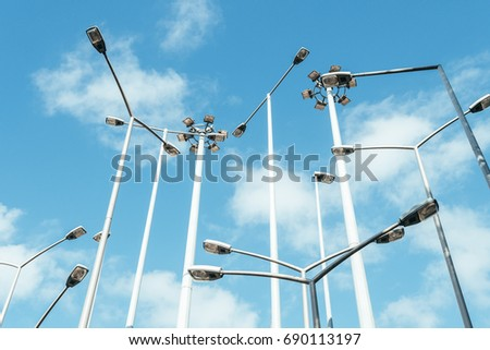 streetlights tangle with clouds at background