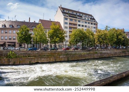 """Streets and water canal in old and beautiful district """"Petite France"""" in Strasbourg. Alsace, France - stock photo"""