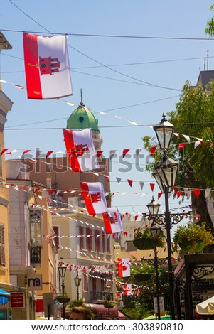 streets decorated with colorful flags in the city of Rock of Gibraltar, Spain - stock photo