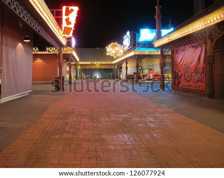 streets empty and posts of a fair to close for the night - stock photo